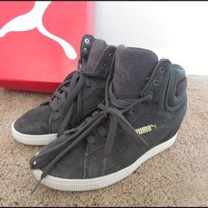 Grey Puma wedge sneakers.